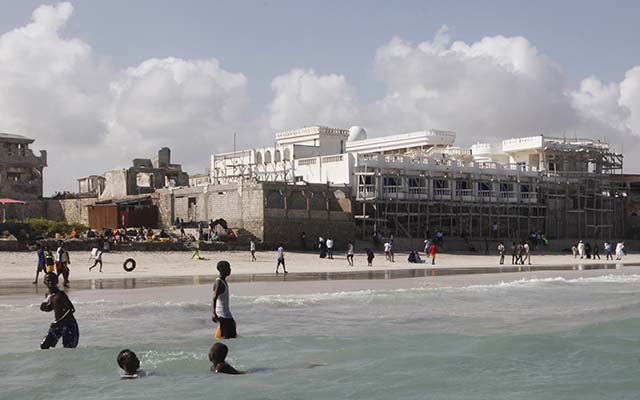 People playing on the beach in Mogadishu, Somalia.