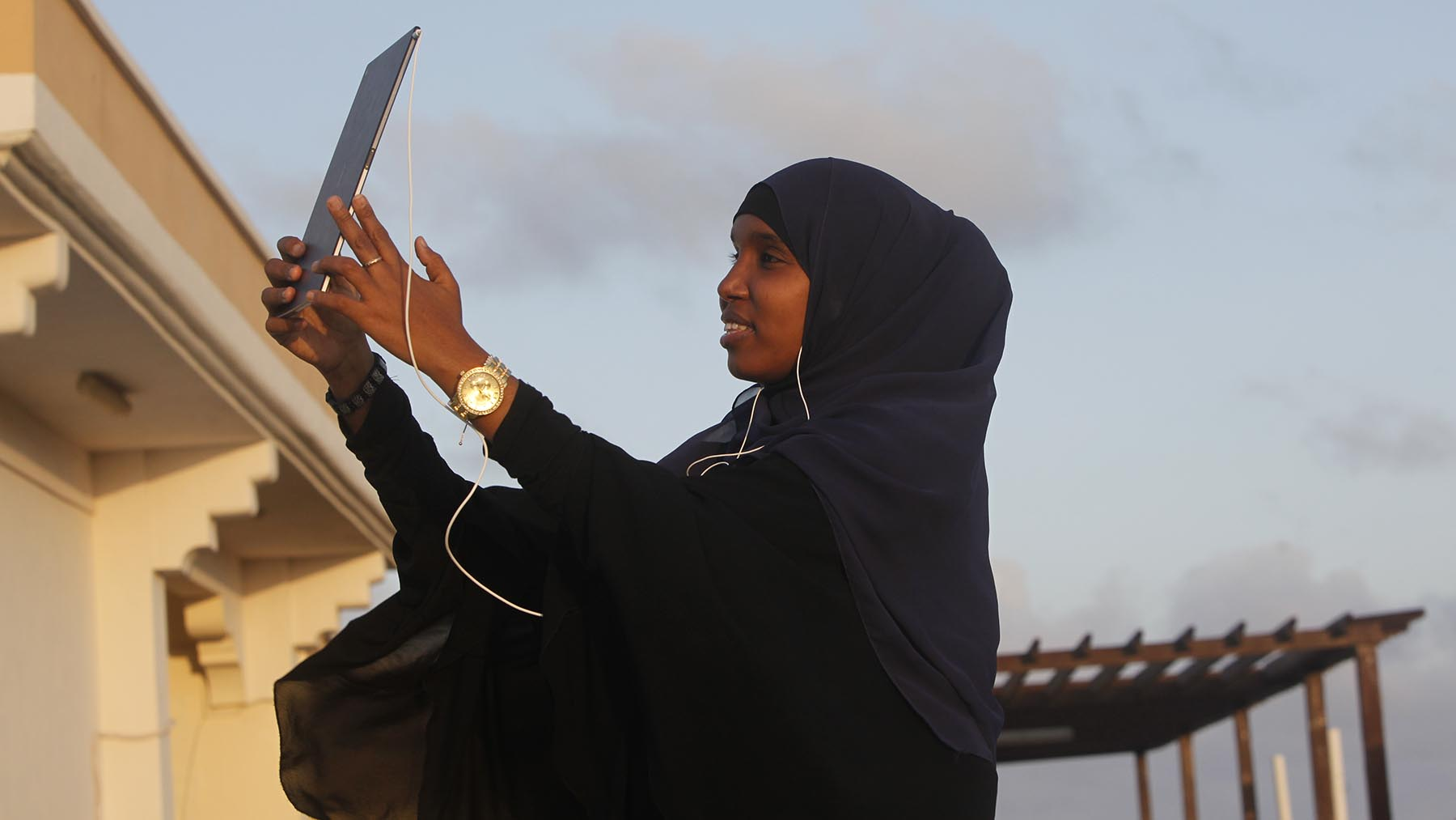 Photo of Zahra Qorane taking a selfie with a tablet.